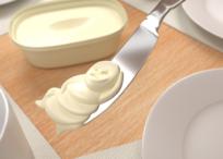 バターナイフで掬われたマーガリン
